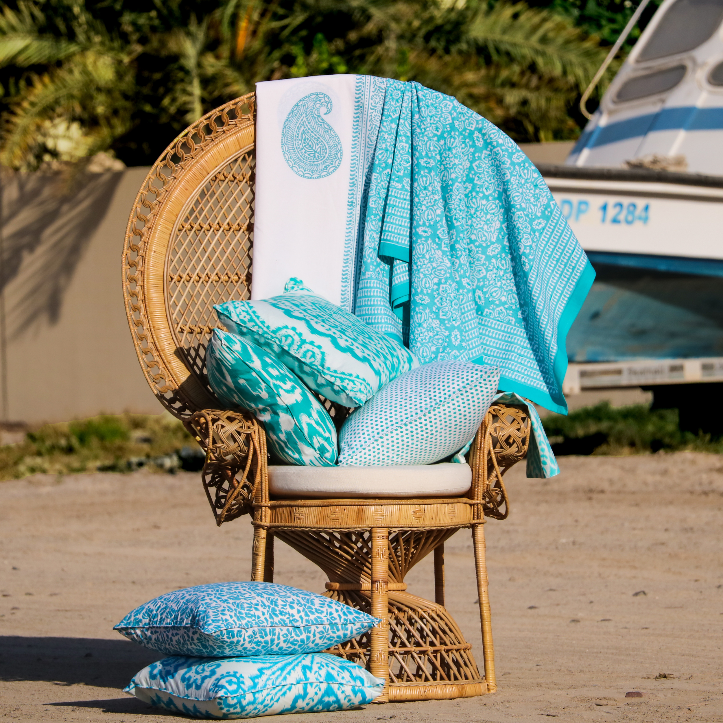 Blu on peacock chair.jpg