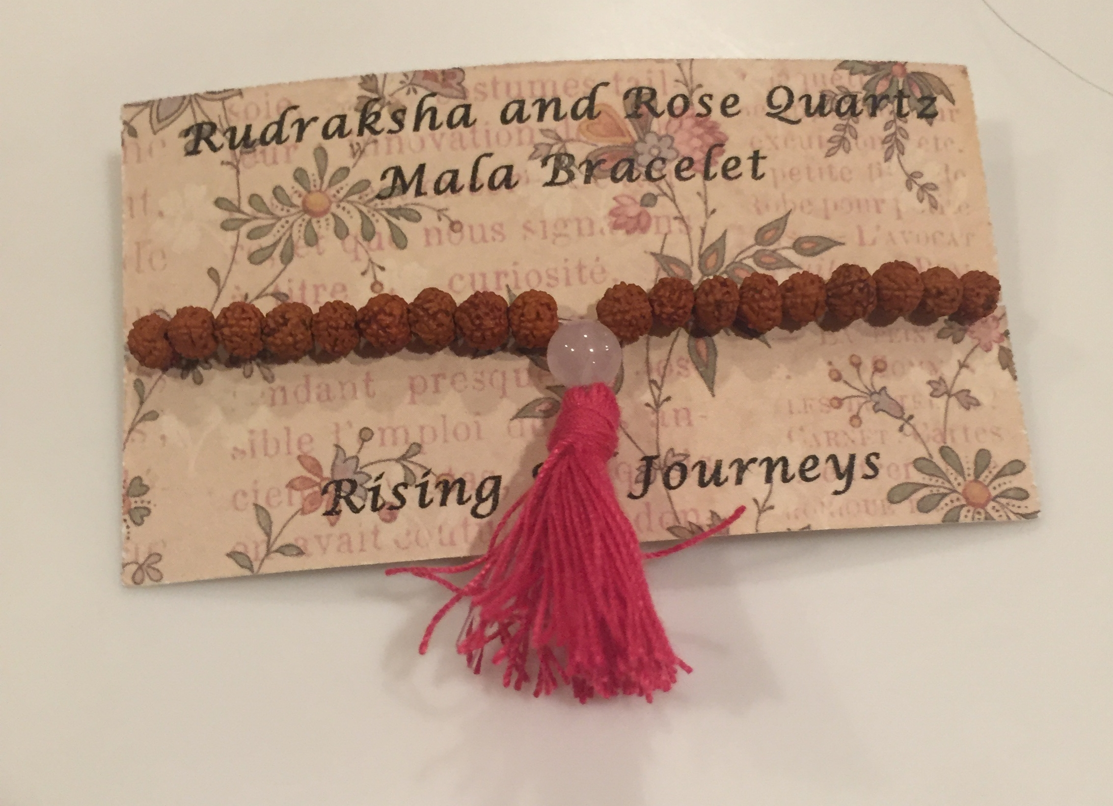 This Rudraksha and rose quartz mala bracelet is currently on my wrist.  It is handmade by Heather using Rudraksha seeds from India and Lakshmi inspired rose quartz.  I love it, and it is a bonus my favorite color is pink :)