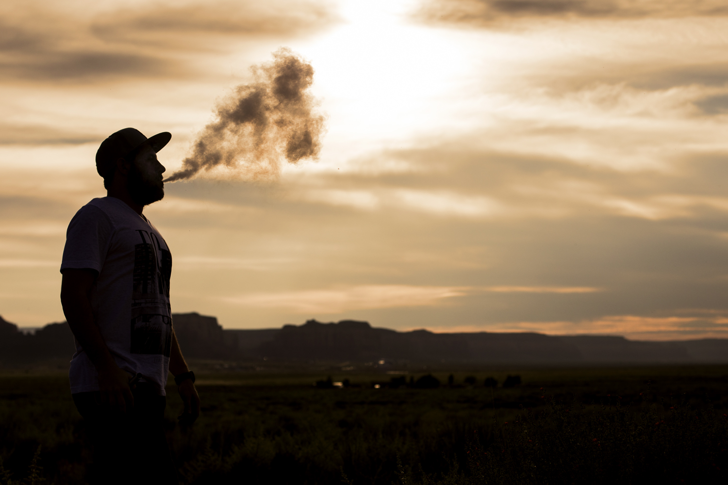 Andrew Scherf vaping along a dirt road in Monument Valley  Canon 6D, Canon 50mm f/1.4 (iso 160, f/4, 1/4000s)
