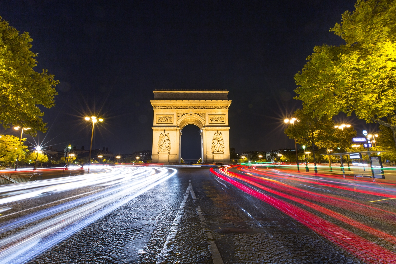 we took a walk from the Eiffel tower to the Arc De Triomphe which was literally down the block. I wish we were there a few minutes earlier to catch the sunset but amongst all chaos of the traffic, I managed to get this shot from the middle of the street.  Canon 6D, Canon 16-35mm f/2.8L @16mm (iso200, f/16, 8s)