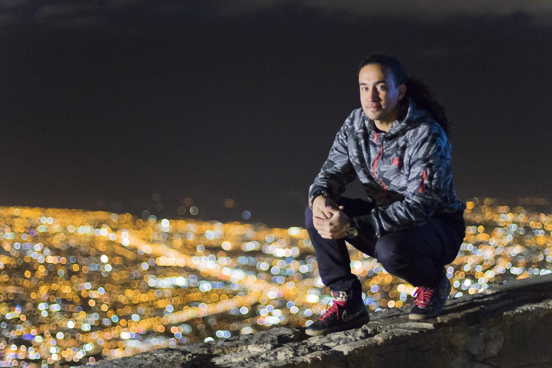 Jon atop the city.  Sony A7II, Canon 50mm f/1.4 (iso3200, f/1.4, 1/100s)