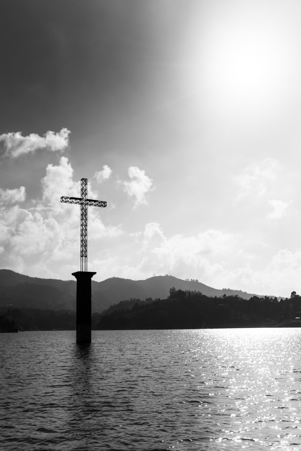 This part of the lake was actually made over a city.  The town was evacuated and flooded to form the lake and give water to neighboring cities.  This cross on top of the church is all that's visible above water.  Sony A7II, Canon 16-35mm f/2.8L II @35mm (iso100, f/5.6, 1/4000s)