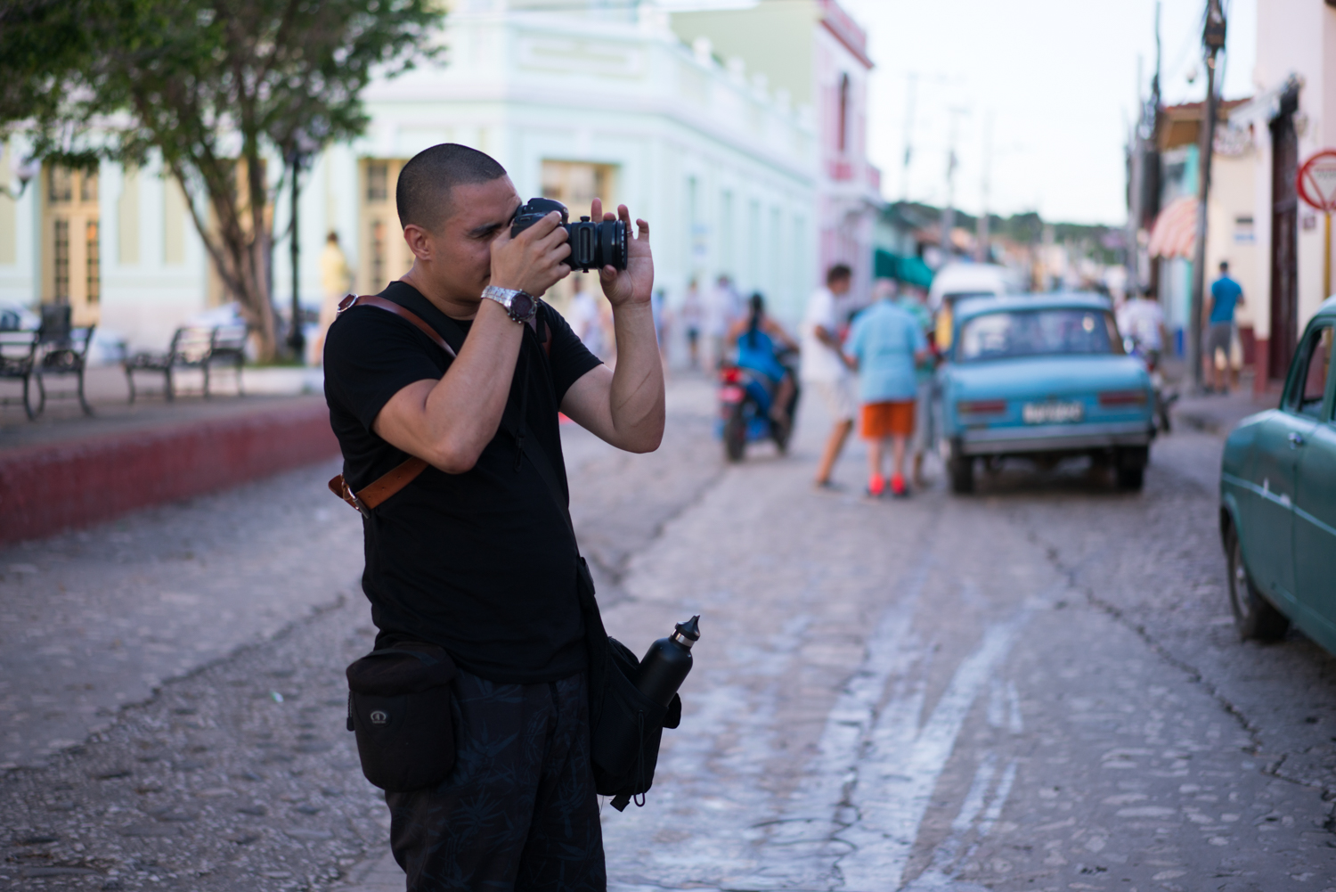 Efrain spotting a photo opportunity.  Sony A7RII, Zeiss 55mm f/1.8 (iso200, f/1.8, 1/250s)