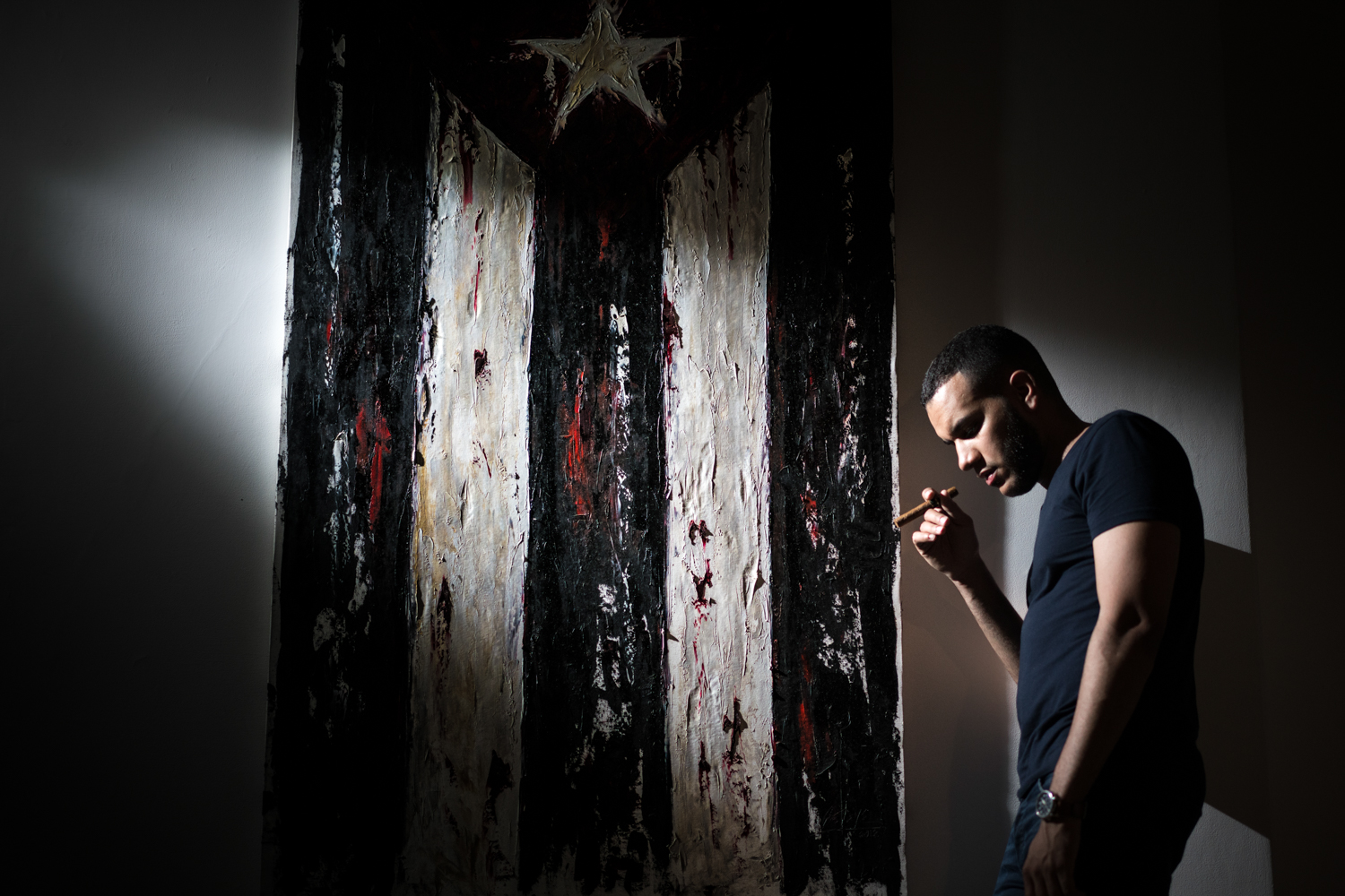 Our AirBNB had this amazing painting of a Cuban flag on the wall and while we were stuck inside during the storm, we took full advantage and I was able to shoot this portrait.  Sony A7RII, Zeiss 55mm f/1.8 (iso1000, f/1.8, 1/160s)