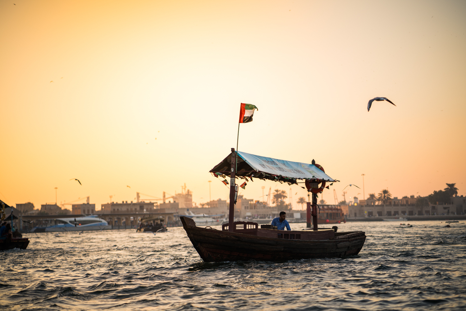 One of the boats cruising through Dubai Creek.  Sony A7RII, Zeiss Batis 85mm f/1.8 (iso250, f/1.8, 1/1250s)