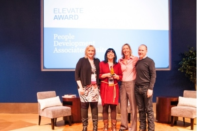 The PDA team Sarah Vogel (first left), Natasha George (second left), David Cripps (first right), receive Fierce's Elevate award in 2013 from Halley Bock (second right).