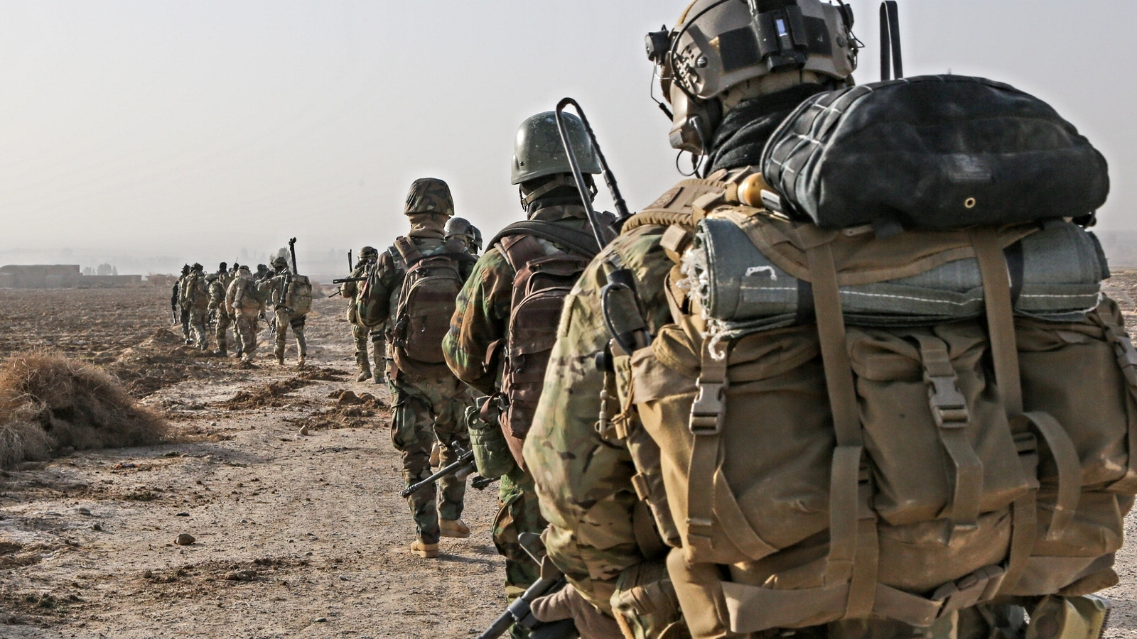 A_U.S._Army_Special_Forces_Soldier_with_Combined_Joint_Special_Operations_Task_Force-Afghanistan_and_Afghan_National_Army_commandos_with_the_3rd_Company,_3rd_Special_Operations_Kandak_move_toward_a_compound_140101-A-LW390-143.jpg