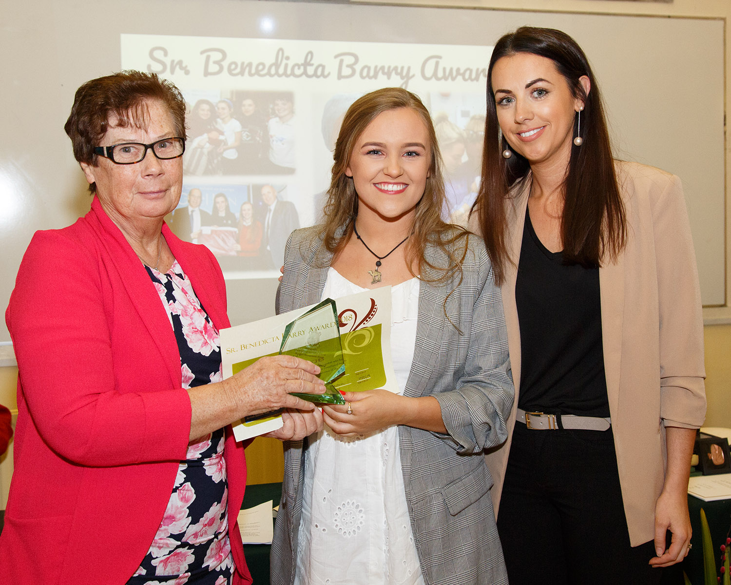 Benedicta Barry Award Winner Madelyn Hughes being presented with her award by Sr Mary Donovan Chairperson of the Board of Management and Sinead Mangan RE coordinator