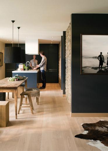 black-kitchen-cabinets-with-oak-floor.jpg