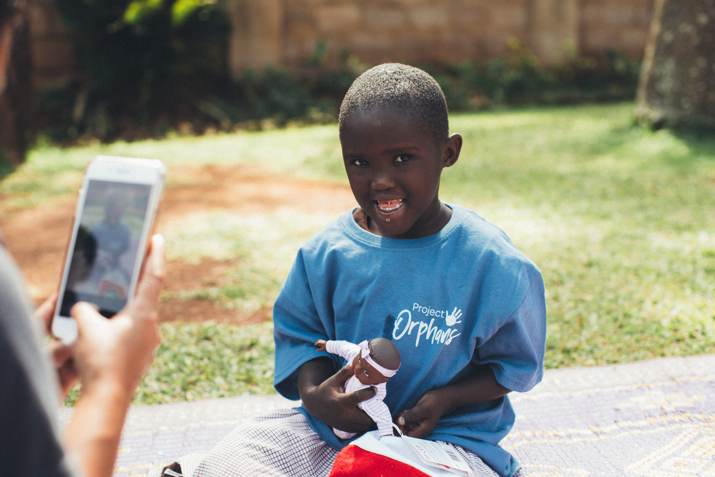 the girl Who Inspired US - Meet Blessing. She was Project Orphan's first child with special needs enrolled into our program. After seeing the impact simple therapies, unconditional love and a healthy diet had on her life our team decided to take the next step and open a daycare for children with special needs. That is how Blessing's Cove came to be!