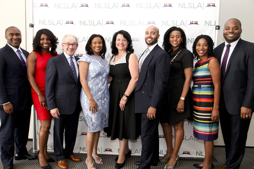 NLSLA Executive Director Neal Dudovitz (3 from L); Kimberly Willis, President Langston Bar (4 from L); NLSLA Deputy Director Yvonne Mariajimenez (5 from L) and John M. Langston Bar Association