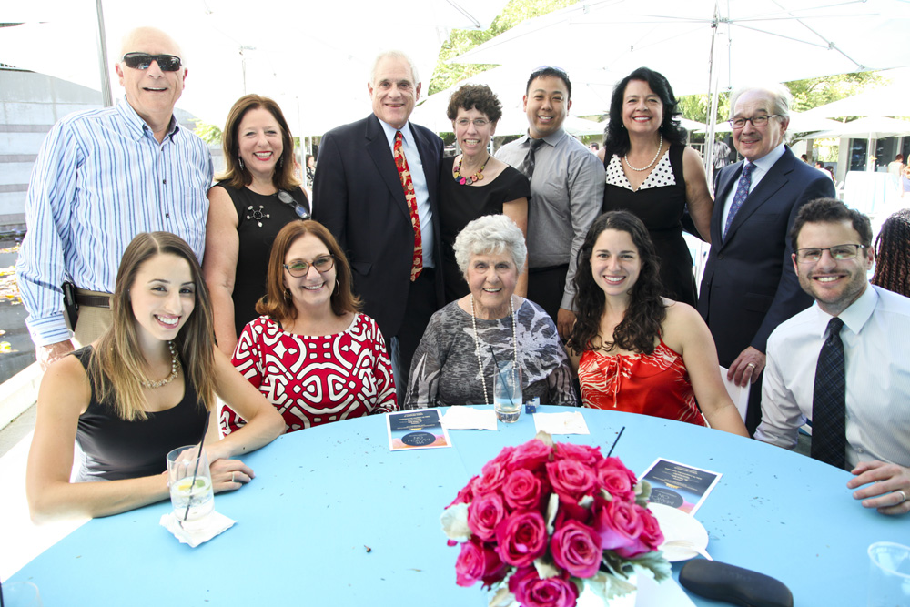 NLSLA Executive Director Neal Dudovitz (2 from R); NLSLA Deputy Director Yvonne Mariajimenez (3 from R) with Siegel, Kamenir, Reznik Families and NLSLA supporters.