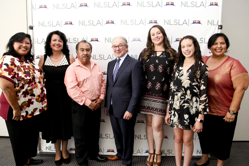 NLSLA Director of Access to Justice Initiatives Ana Maria Garcia (L); Yvonne Mariajimenez (2 from L); Neal Dudovitz (Mid); Monica Garcia (R) with Family of Marta Sanchez