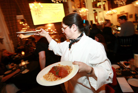 Lisa Schroeder serving up spaghetti and meatballs at one of our first screenings at Mother's Velvet Lounge. This photo was taken by  Craig Mitchell Dyer  for  The Oregonian's A&E  section.