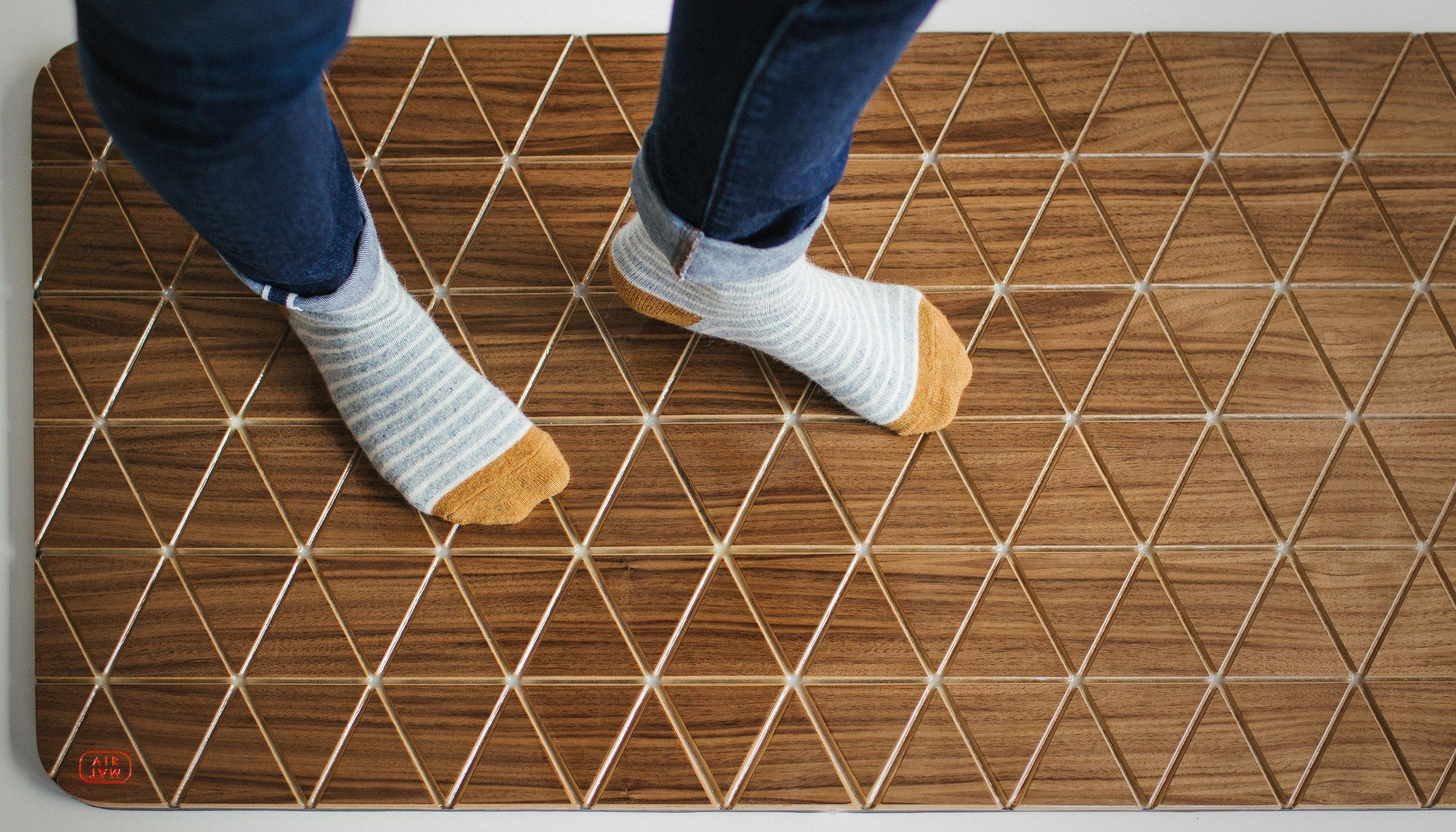Airea Floor mat Walnut feet.jpg