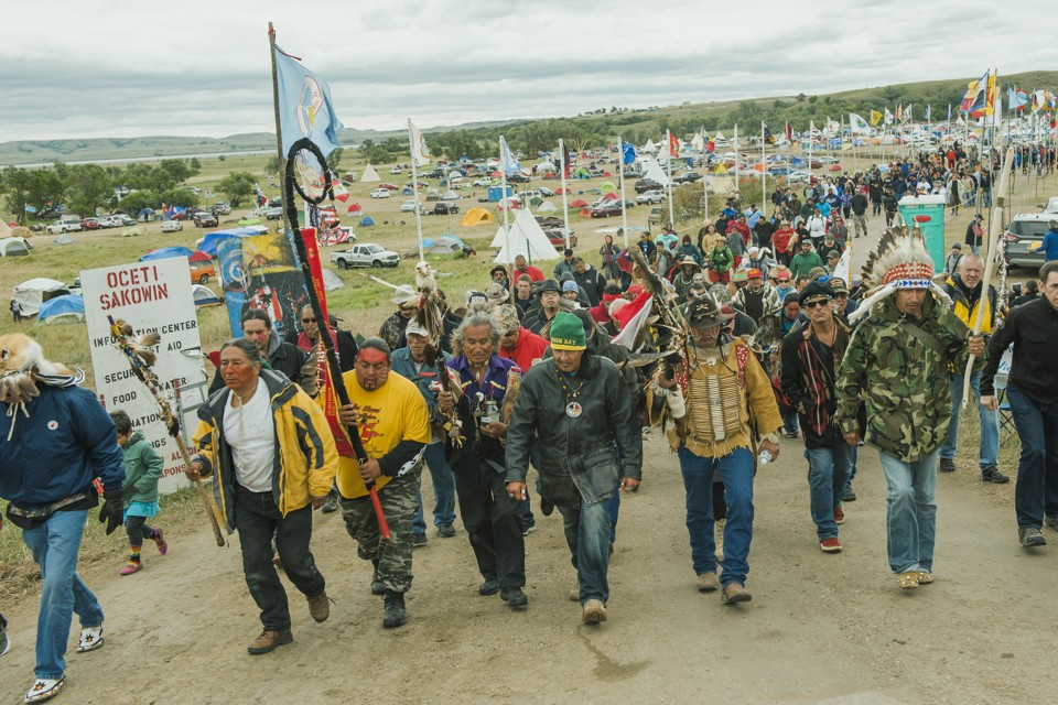 Protestors join together in a march against the construction of the Dakota Access Pipeline.
