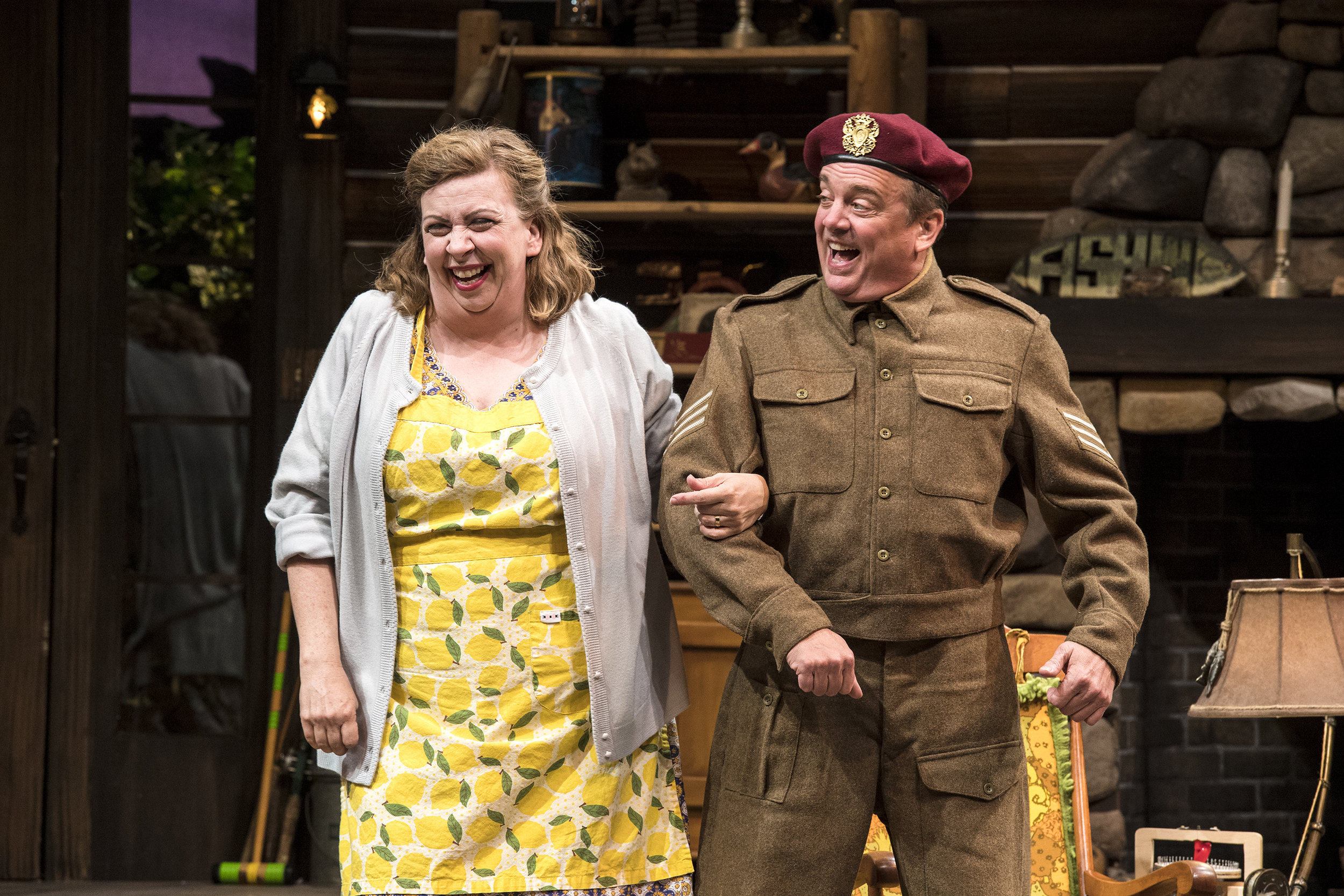 "Colleen Baum (left) as Betty Meeks and Chris Mixon as S/Sgt. ""Froggy""  LeSueur inthe Utah Shakespeare Festival's 2018 production of  The Foreigner.  (Photo by Karl Hugh. Copyright Utah Shakespeare Festival 2018.)"