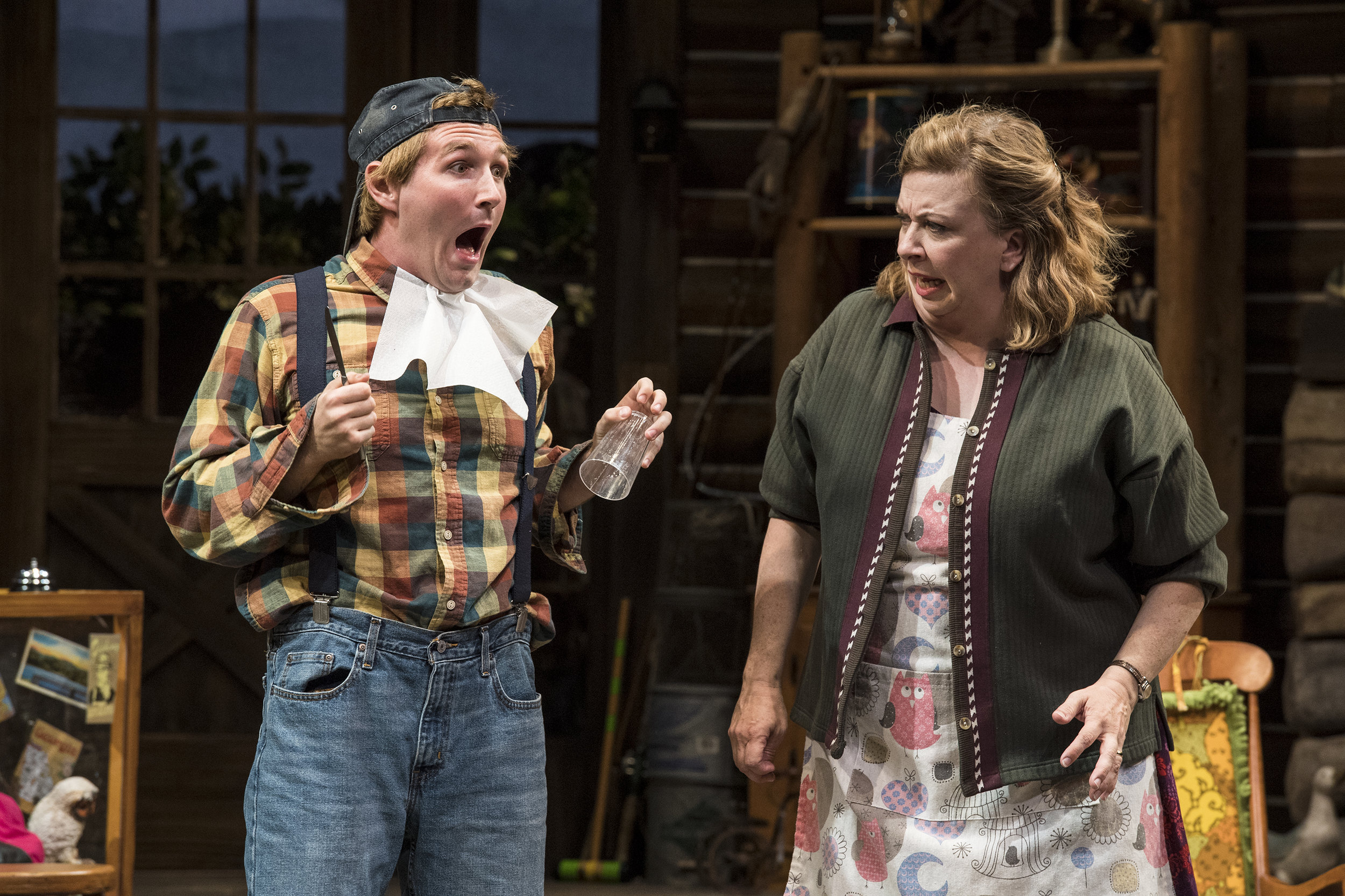 Rob Riordan (left) as Ellard Simms and Colleen Baum as Betty Meeks in the Utah Shakespeare Festival's 2018 production of  The Foreigner.  (Photo by Karl Hugh. Copyright Utah Shakespeare Festival 2018.)
