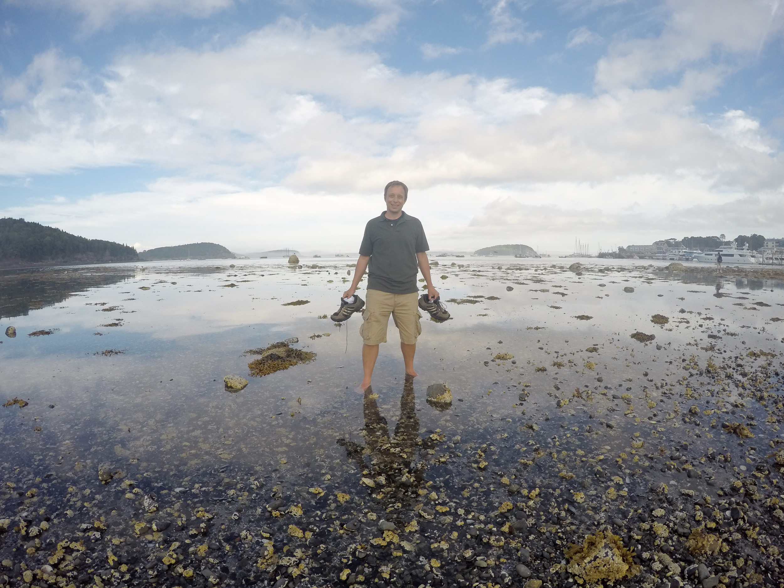 This is what happens when the tide comes back in so unexpectedly fast. Mark had a little dry path to walk out and look at some pools and two minutes later, his path was gone. He had to balance on a rock and take off his shoes so they wouldn't get soaked.