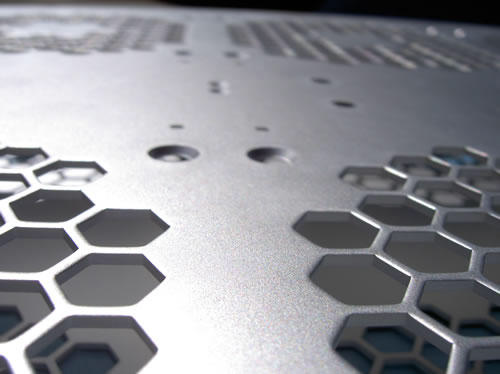 Aluminium sheet metal part with hexagonal holes punched at close pitch