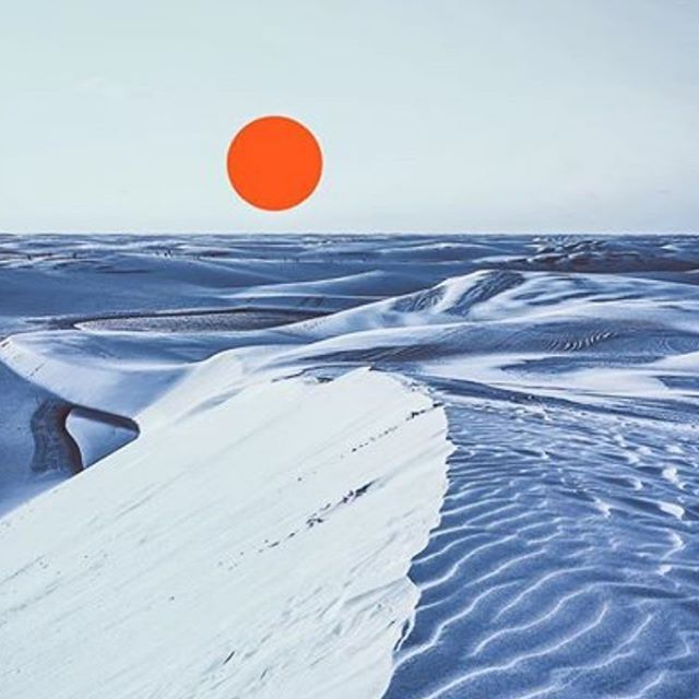 : #orangedot  a @_.__komorebi__._ #original #floating #orange #dot above a #chilling #snowcovered #landscape