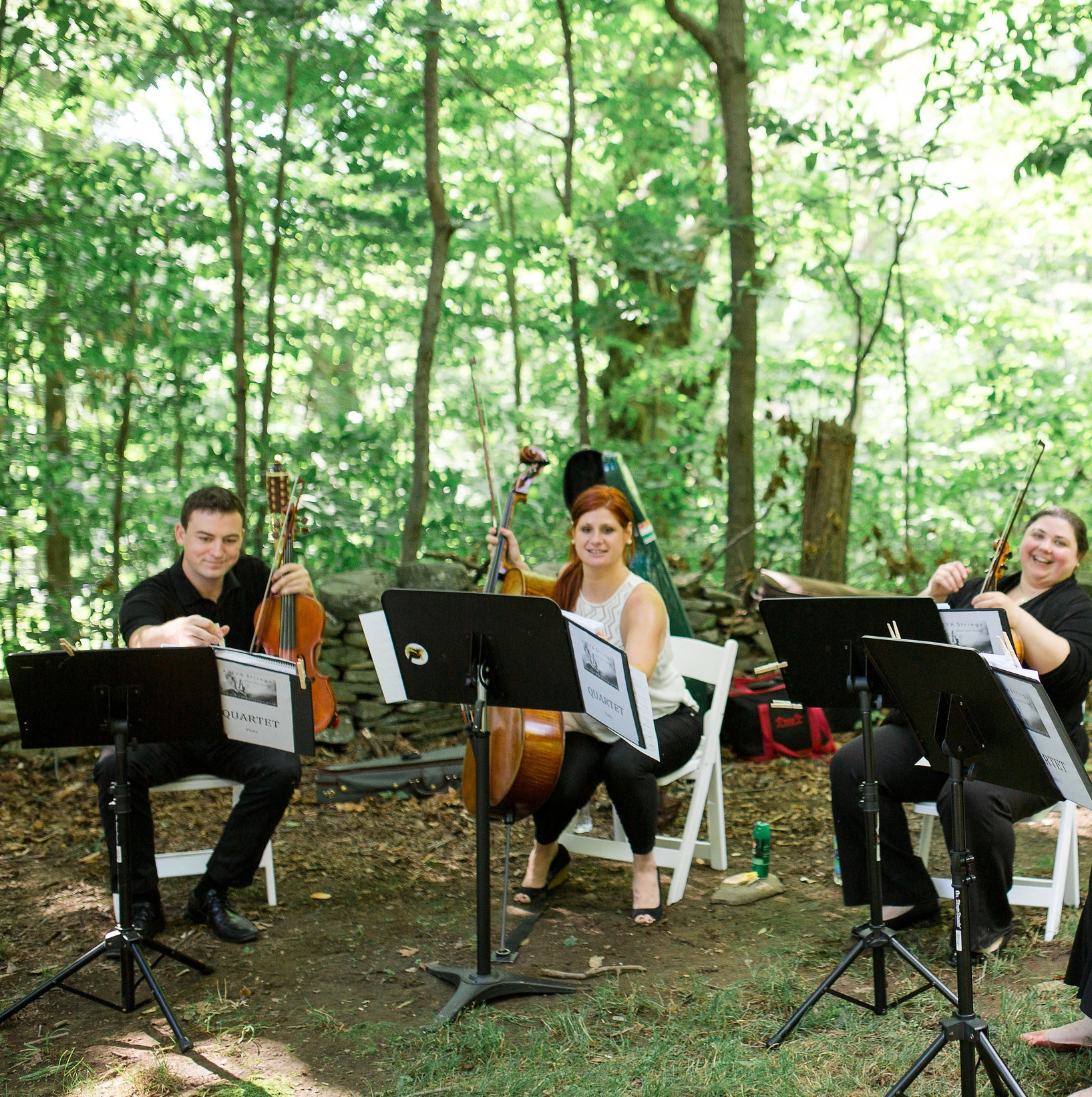 Gorgeous photo, courtesy of Danielle Coons Photography, of AVIVA Strings' quartet enjoying some pre-ceremony time in the woods!