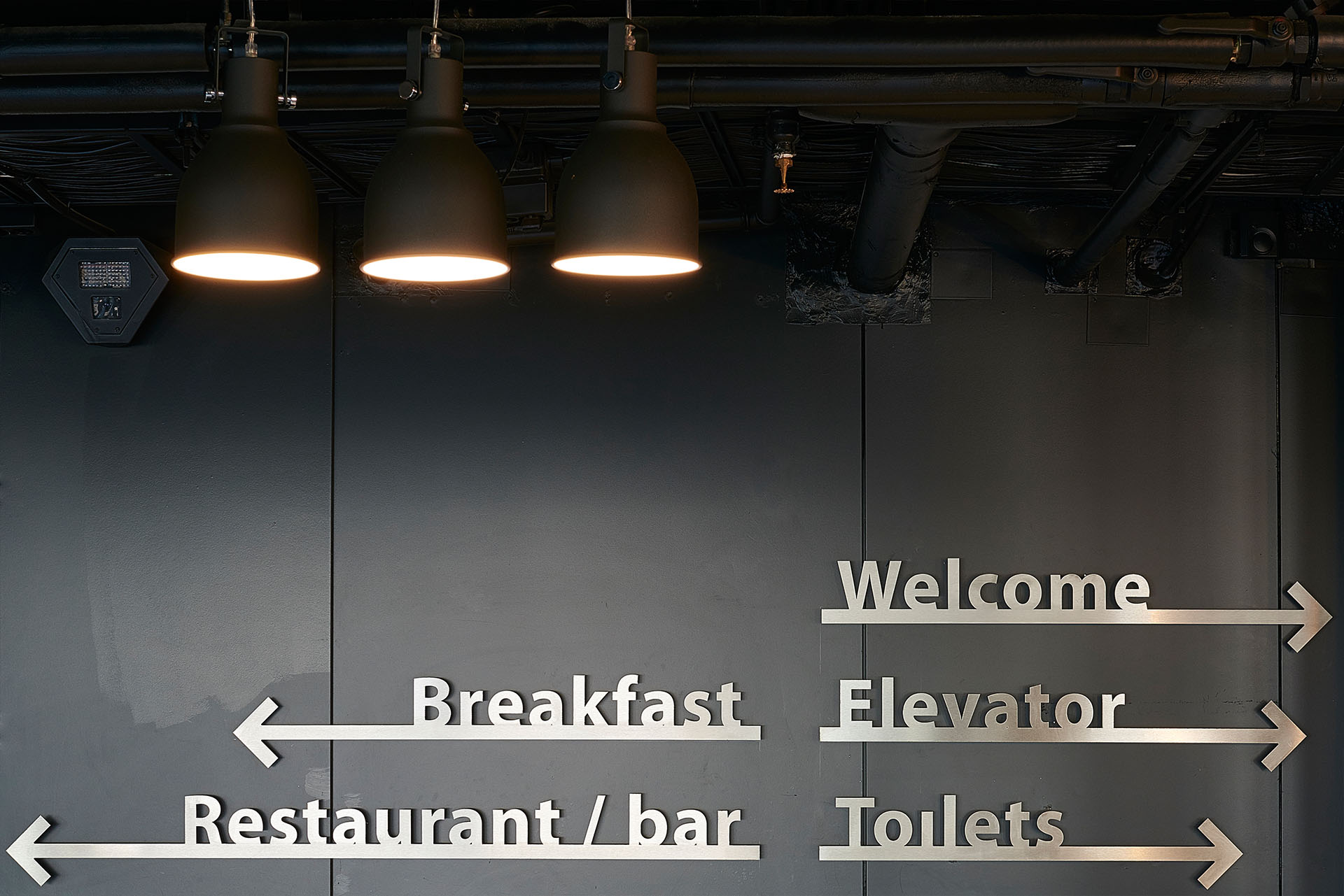 Signage  / Water-cut stainless steel signage to match the industrial feel of Good Hotel Amsterdam.