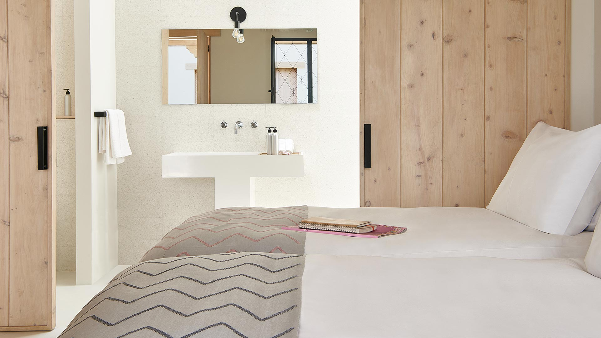 Pila Room  / Sliding doors reveal the signature PILA sink. The typical T-shaped design is inspired by local washing culture that can still be found in the older homes and market squares of Antigua.