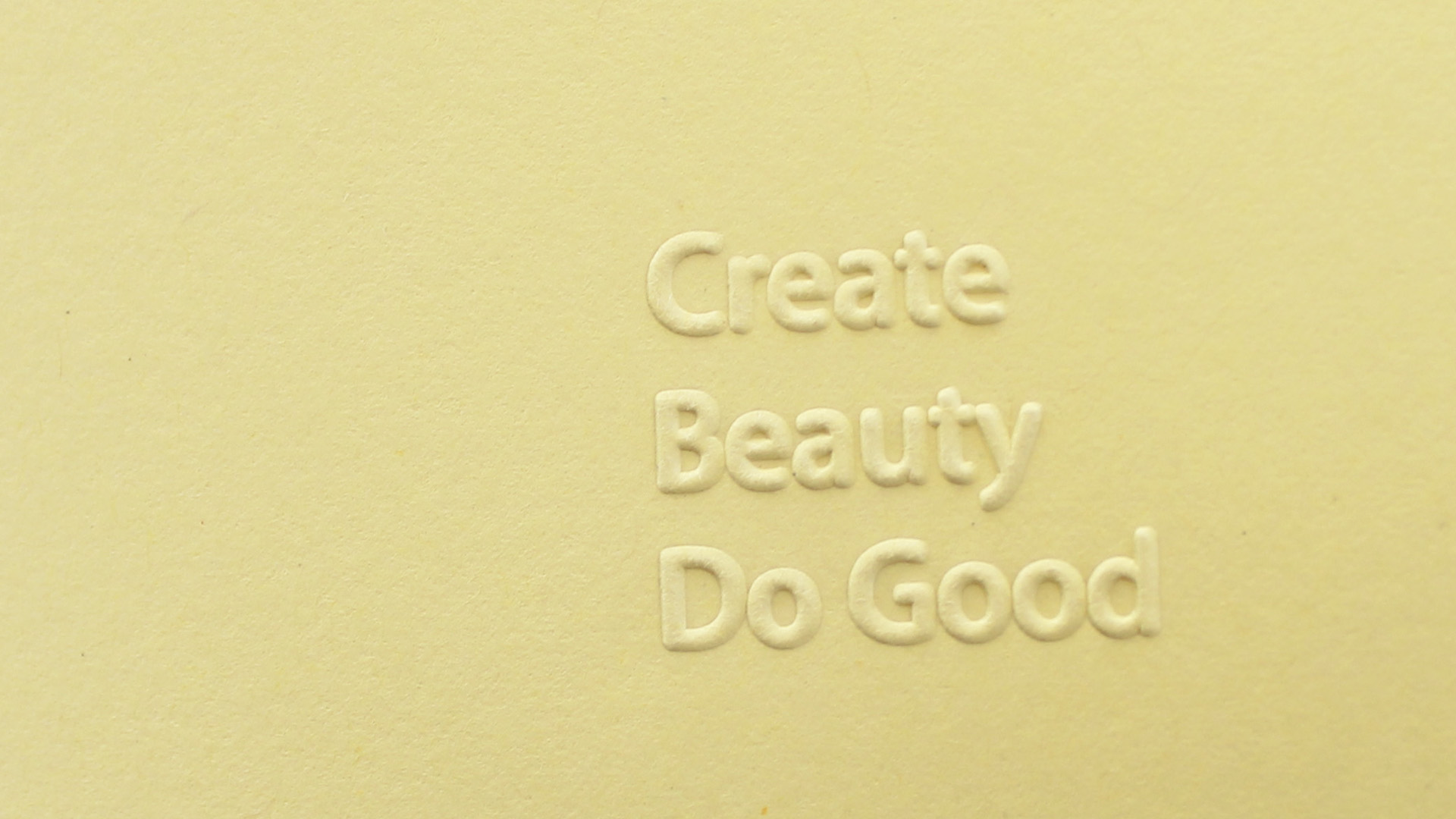 Embossed  / The Create Beauty Do Good motto is letterpressed on the cover.