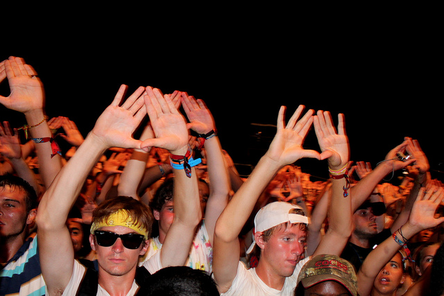 A crowd during a Jay Z concert, raising his iconic Rocafella Records diamond. C.C. Image: Jade McClelland on Flickr.