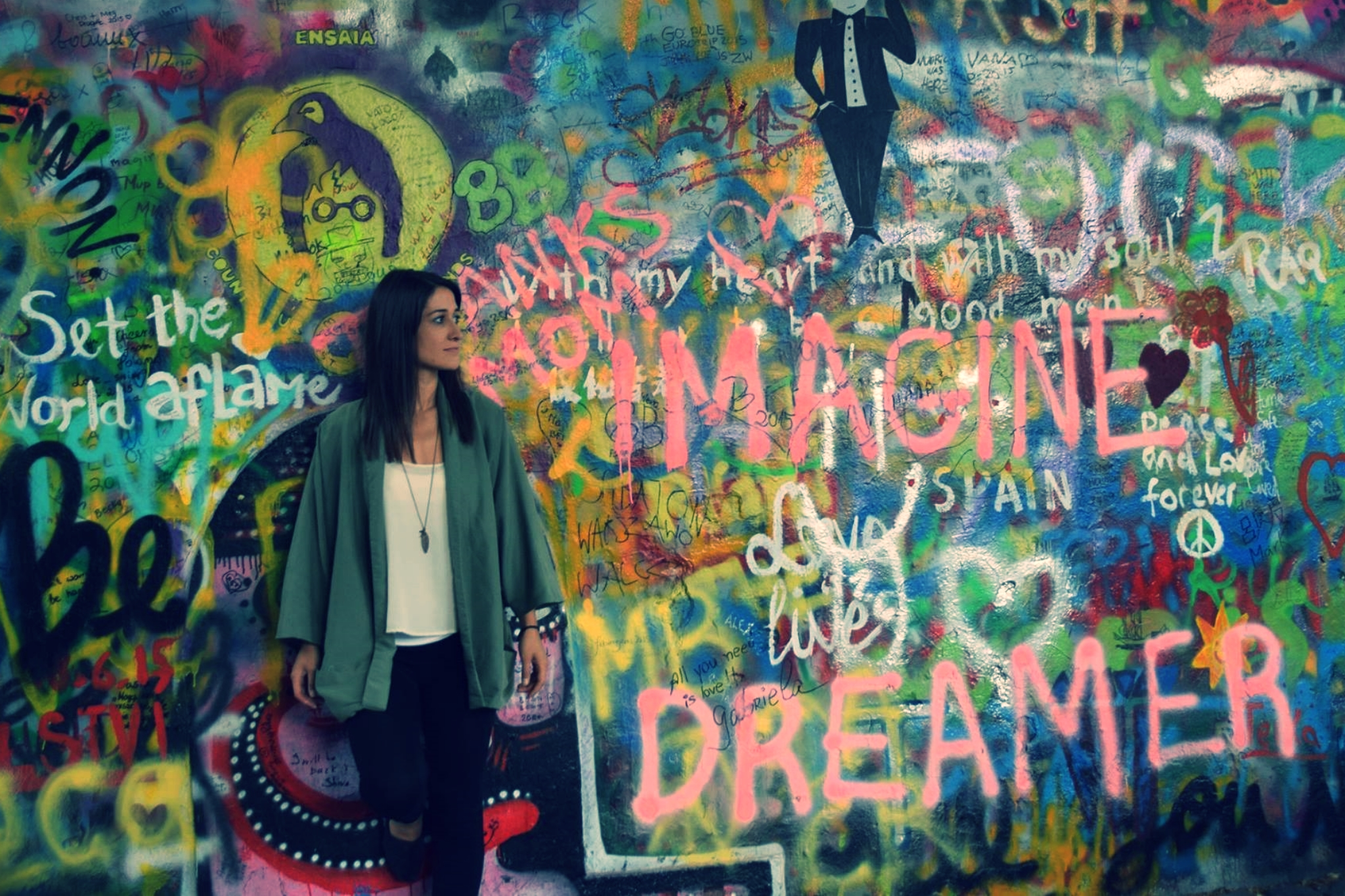 """John Lennon wall, Prague, Czech Republic.I wrote the words in pink on the wall. this includes, """"Thanks, Mom"""" behind my head and the words """"Imagine"""" and """"dreamer"""" because those words sum up my life and I truly believe in the lyrics of that song."""