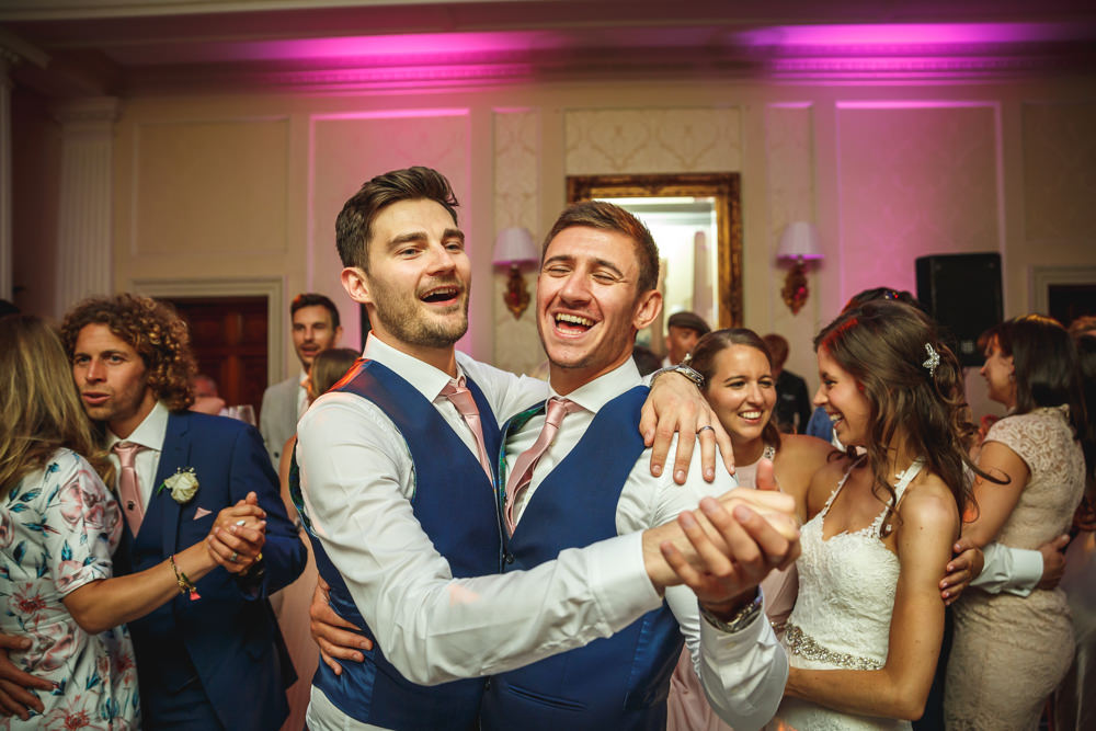 54. Fun on the dancefloor - Groom & Groomsman.JPG