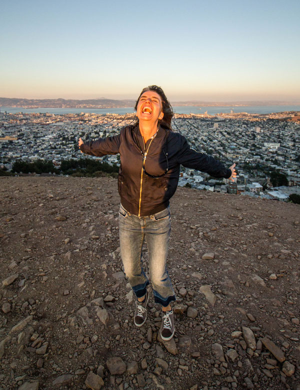 My wife Clare, confidently standing on the top of the world aka as San Francisco's Twin Peaks in 2015. One of my favourite pictures of her. She is taking her space!