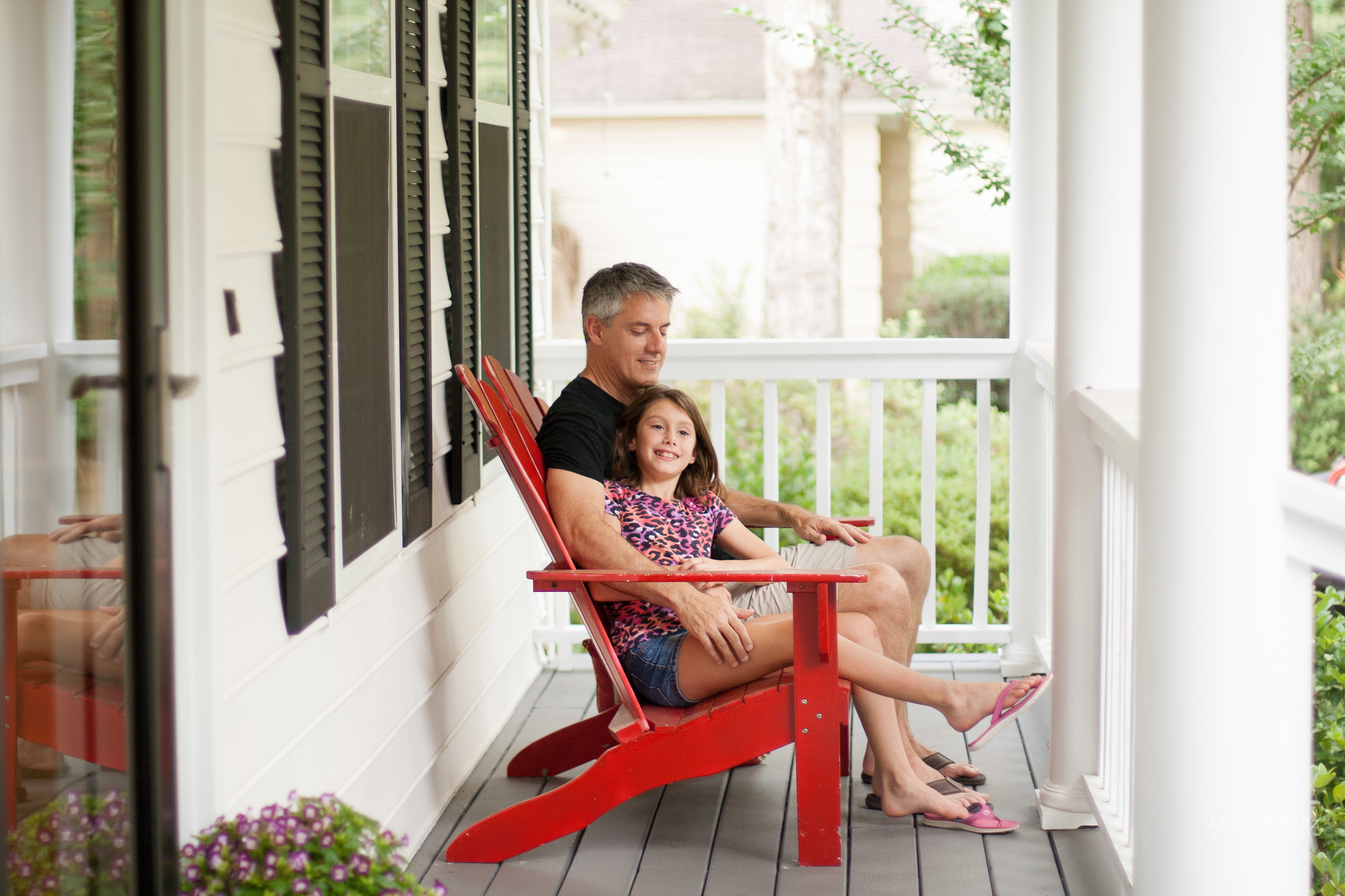 Father and Daughter bonding on porch
