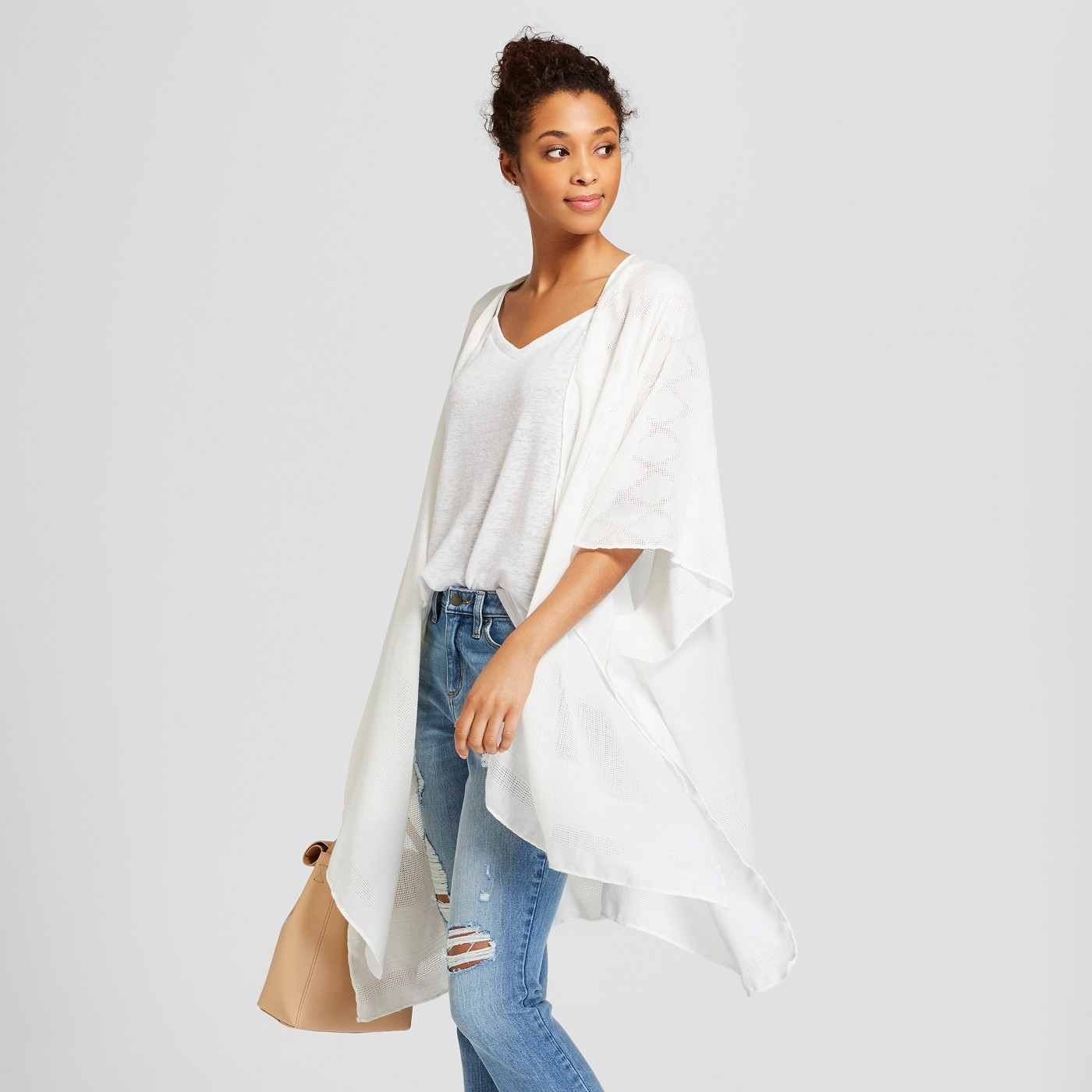 - This staple Kimono is a great layering piece and can also break up a dress with a busy pattern