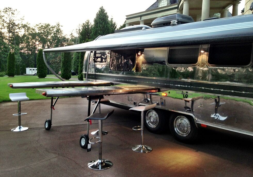 Airplane wings are used as outdoor bar extensions
