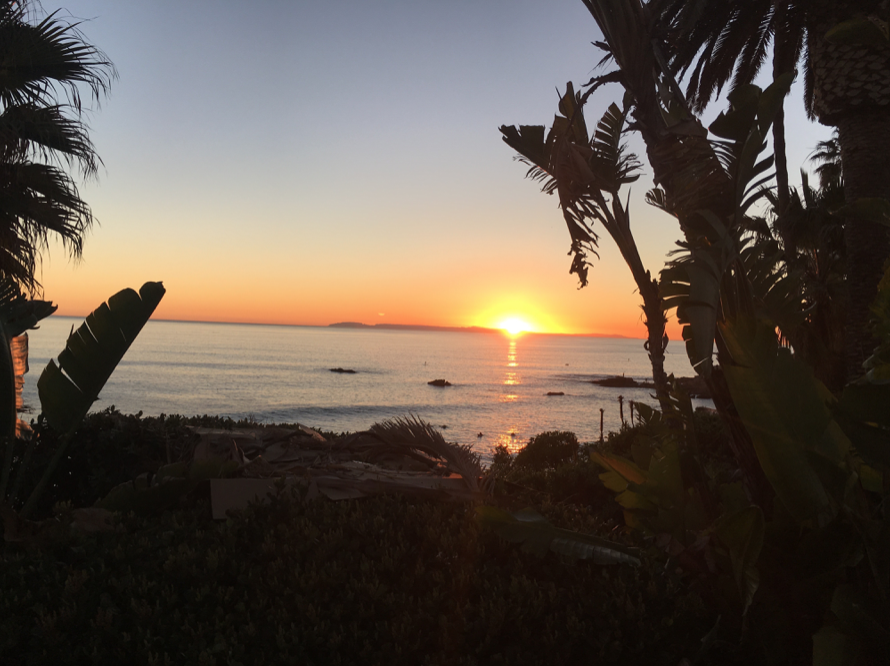 Sunset walk at Heisler Park - filled with people.