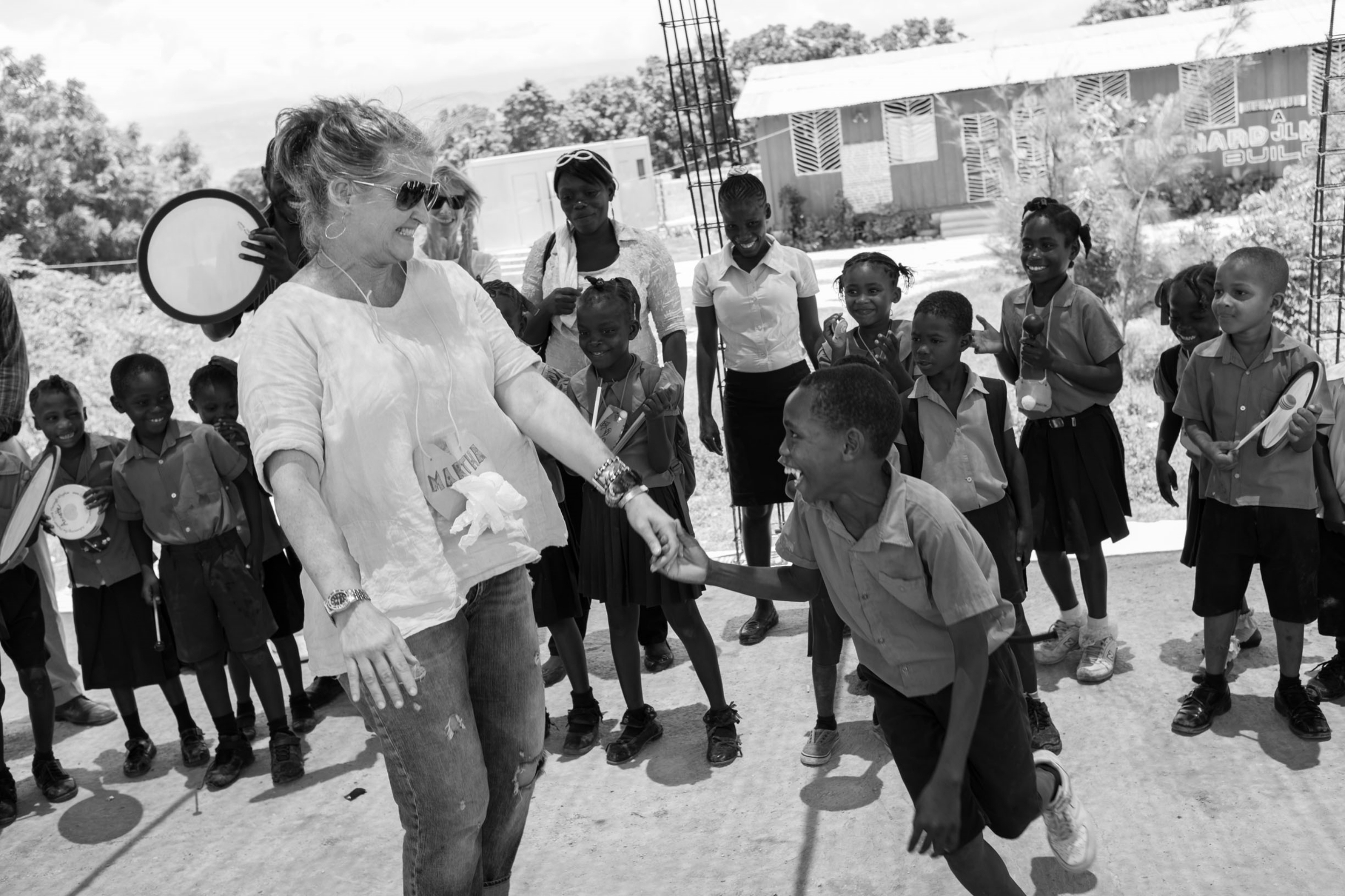 ArtReach Executive Director, Martha Henson in Haiti 2014 | Ideal example of the spontaneity that is derived from an ArtReach program.