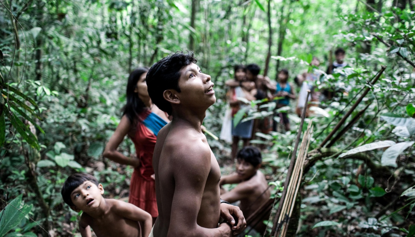 A group of Awá taking a break in the forest during hunting.