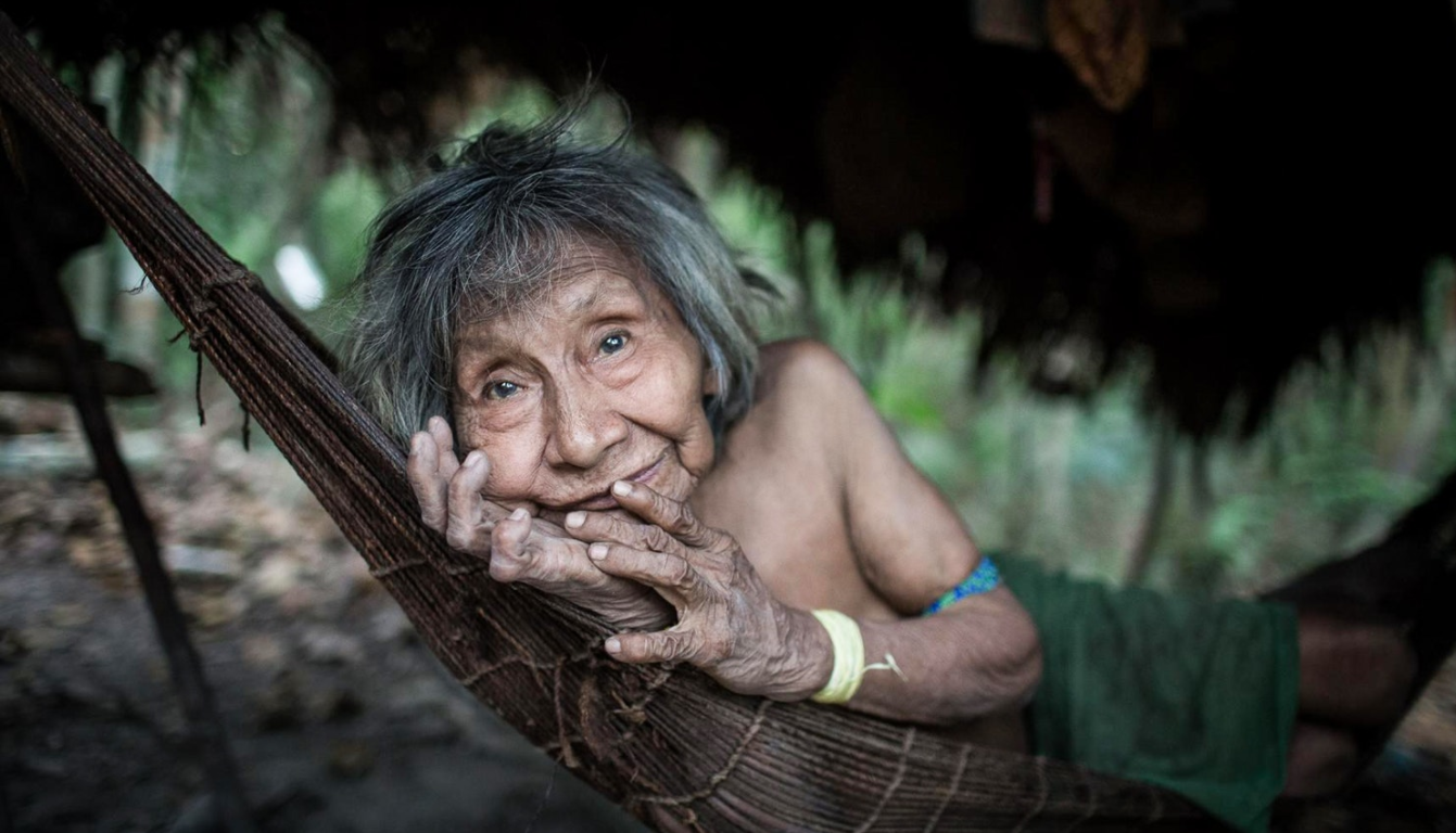 Amerixaá is the oldest woman in the Awá tribe. She lives deep in the jungle, far from the rest of the community. In Awá culture, older members traditionally remove themselves from the tribe, living alone until they pass away.