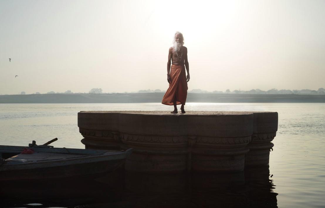 Above:Shiv Ji Tiwari stands on a sunken temple in Varanasi.
