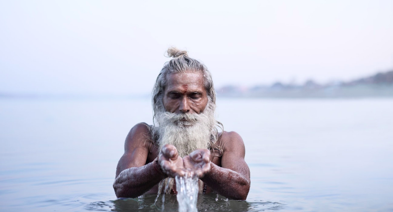 Above: Vijay Nund performing morning rituals in the Ganges River, the most sacred river in Hinduism.