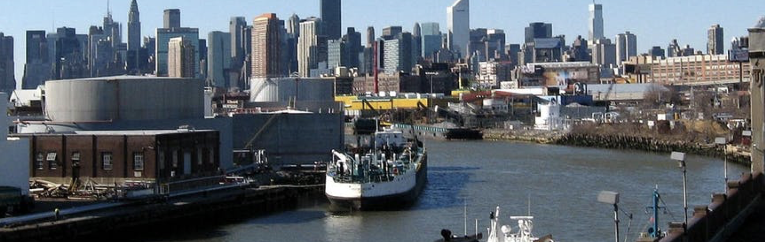 Small tankers unload along New York's Newtown Creek in 2008.