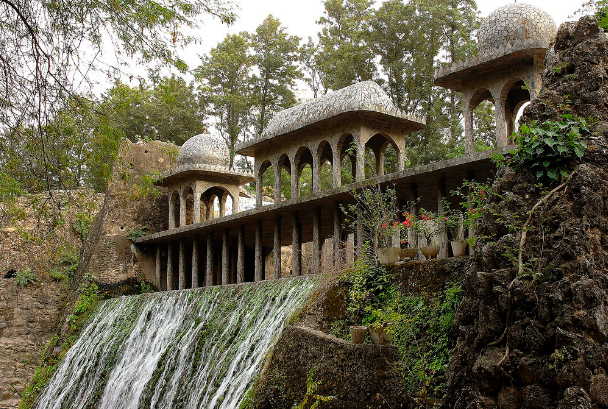 A picturesque waterfall in the Rock Garden of Chandigarh. Image Credit: Atlas Obscura
