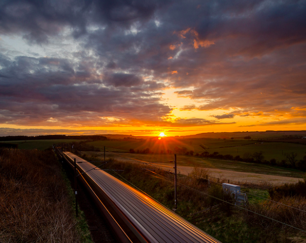 Traveling by train is a great way to reduce your carbon footprint and see more of the place you are traveling through. Image Credit: Jonathan Combe. CC BY 2.0