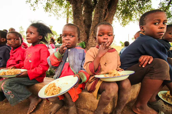 How can photographers be more sensitive towards their subjects?  Feed My Starving Children (FMSC) ,  CC BY