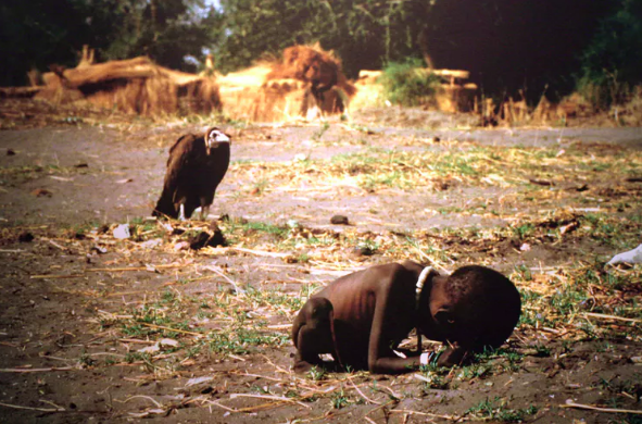 Kevin Carter's photo shows a starving girl with a vulture next to her.  Cliff