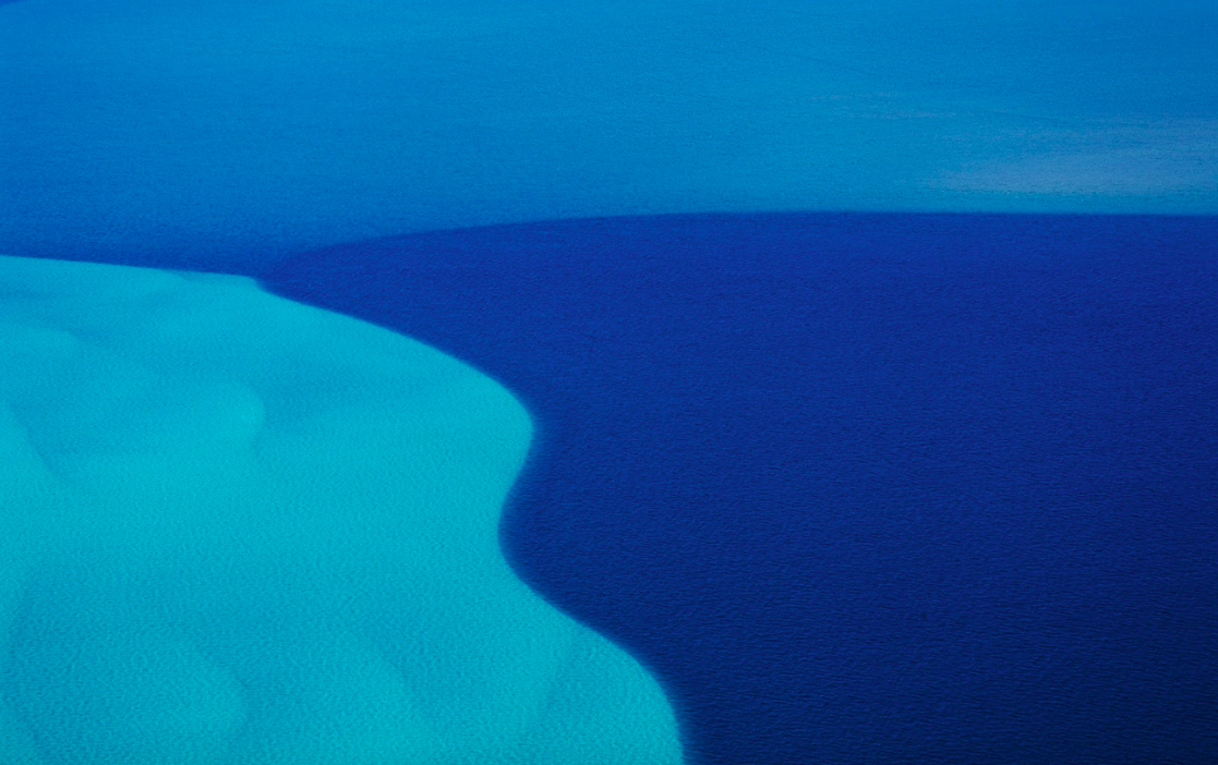 Ocean between Ningaloo Reef and Coral Bay, Western Australia. The blue variation is due to the ocean's floor level. (Taken 2006)