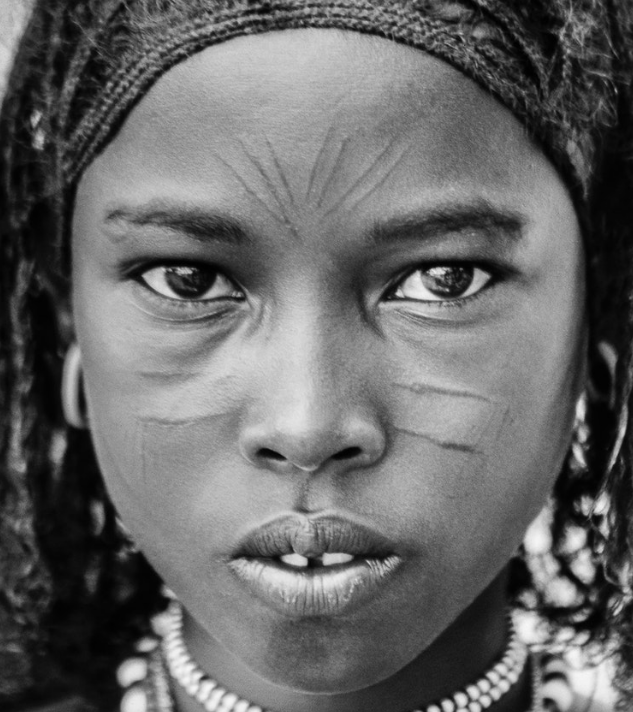 A young girl of the Afar tribe, from Ethiopia. Her people are fiercely proud and independent, having lived forever in the harsh deserts of the Horn of Africa, as semi-nomadic cattle and camel herders.    Ethiopia