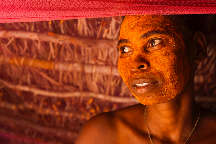 Seeking shelter from the relentless sun, I was invited in by this beautiful Antandroy woman, who was wearing a traditional mask made of powdered bark, a natural mosquito repellent and sunblock. She too was feeling unwell and I was moved by her humble hospitality and grace.    Madagascar